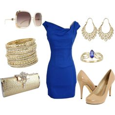 Blue dress with a lot of gold in the accessories!