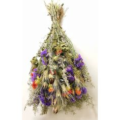 This colorful bouquet is called Garden Parade- isn't that just perfect for this vibrant bunch of dried flowers? The best part is that these flowers will last longer than those in your garden, and they are available now! #springfever #springdecor #happyflowers #homedecor #livingroomdecor #driedflowers #color #countryliving #farmhousedecor #flowers #weddingbouquet #weddingdecor #weddinginspiration