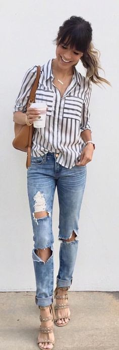 #spring #outfits woman in white and black striped 3/4 sleeved blouse and distressed blue jeans. Pic by @interiordesignerella