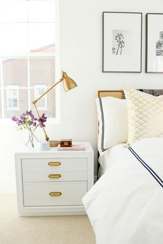 We love a full-on whiteout when it comes to the bedroom. A white-on-white bed is like an invitation to jump on a cloud and, when paired with a white nightstand, simply irresistible. We love how you can add pops of color with seasonal flowers or chrome accents.