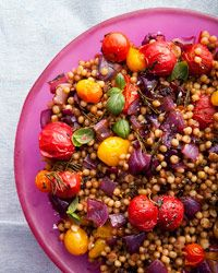 Fregola with Charred Onions and Roasted Cherry Tomatoes Recipe from Food & Wine- sub couscous for fregola and grill the onions and tomatoes instead!