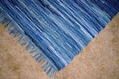 Handwoven rag rug, recycled denim, 5 ft X 27 in, with fringe via Etsy (log cabin wide spaced warp)