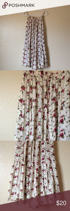 Boho Floral Maxi Skirt Super cute and flowy floral maxi skirt, one size fits all but would recommend for a S or M. Skirts Maxi
