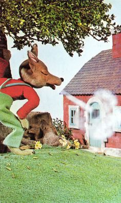 This is an image of the big bad wolf trying to blow down the brick house that one of the pigs had made. The magic in this is that the wolf is wearing clothes, also you can see his breathe hitting the door when he is blowing. Another magical part of this image is how big the wolf is. He is almost as big as the house that the pigs had made