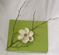 painted canvas with stick and paper flower