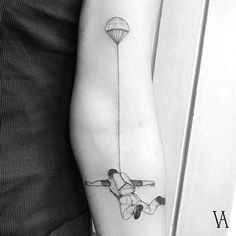 arm tattoo skydiver