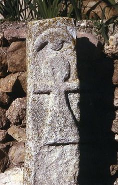 The Sign of Tanit on a votive stele with a crescent moon over the figure - Click on the images to visit the Historyteller website.