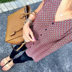IG @mrscasual <click through to shop this look> Pleione printed top.  Banana Republic denim legging.  Report Signature jeweled sandals.  Tory Burch square robinson tote.  Kendra Scott.
