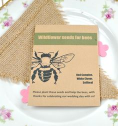 Eco-friendly recycled bee seeds wedding favour containing British wildflower seeds for bees - eco-friendly wedding favour to help save the bees!