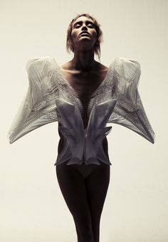 Fashion Architecture - wearable sculpture with a complex structured 3D construct; sculptural fashion