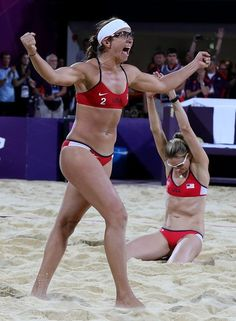 Misty May-Treanor, left, and Kerri Walsh celebrate seconds after winning the gold medal in the London 2012 Olympics beach volleyball final. It was their third consecutive gold medal in the event, and they retired after winning the gold. Robert Gauthier / Los Angeles Times