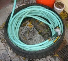 Used tire hose caddy.  Great idea!!