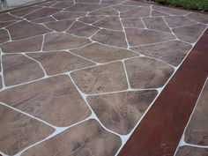 This decorative concrete driveway was created in Cape Coral FL.  5 colors and two antique colors were used to create this one of a kind, driveway to compliment the existing landscape and add to the homes resale value as well as the curb appeal