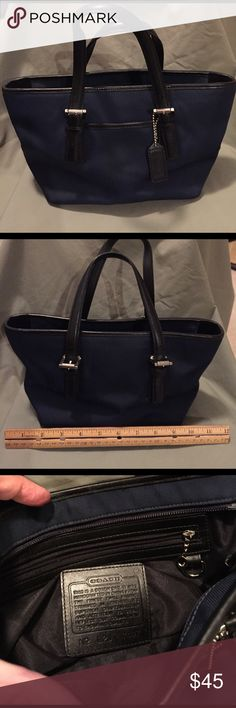 Coach mini purse -blue nylon/black leather handles Authentic Coach purse in dark blue nylon with black leather piping and straps. Silver buckles. Excellent condition. Coach Bags Mini Bags