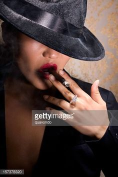 asian-sexy-young-woman-portrait-smoking-cigar-in-30s-fedora-picture-id157378320 (339×509)