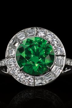 Green with envy. Ring in platinum with an esteemed, 3.52-carat round demantoid and round brilliant and baguette diamonds.