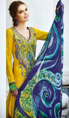 Cause others to yearn to look as beautiful as you dolled up in yellow crepe silk printed churidar kameez. The beautiful block print work a significant element of this dress. #NewStyleCasualDress