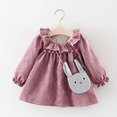 * Flounced detail<br /> * Back zipper<br /> * Pompon decor<br /> * Cozy and soft<br /> * Material: 32.1% Cotton, 67.9% Polyester<br /> * Machine wash, tumble dry<br /> * Imported<br /> <br /> Decorated with sweet flounce and little pompon, this long-sleeve dress makes your girl feel cozy and lively all the time.