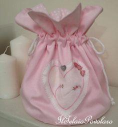 Ed infine un sacchetto ... non solo per un bebè, ...  ma ancora a punti tradizionali