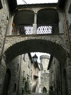 Looking up a narrow lane to one of the castle towers in Malgrate, Italy.