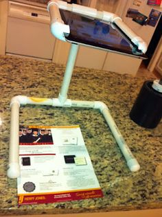 This blog post has lots of images documenting how to build the PVC pipe iPad document camera / scanning stand.