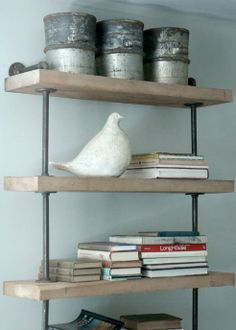 salvaged wood and pipe shelving.  photo by  james huniford, est magazine.