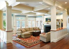 sunken family room, coffered ceilings, hardwoods, builtins, windows, columns