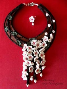 Cherry blossoms...leather, miyuki seed beads, fresh water pearls and sterling silver designed by Nur Varol Gunesel
