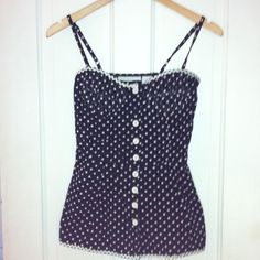 Care-to-Polka? Corset Top Black and white polka dot corset top. Front button closure, adjustable spaghetti straps, adorable white ric rac trim. Fitted bra-like boob area, flares out at the waist. 100% cotton. This top is designed as a shirt, not an undergarment, but hey, do what makes you happy! Charlotte Russe Tops