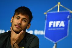Neymar Photos Photos - Neymar of Brazil looks on during a Brazil press conference ahead of the 2014 FIFA World Cup Brazil opening match against Croatia at Arena de Sao Paulo on June 11, 2014 in Sao Paulo, Brazil. - Team Brazil Press Conference