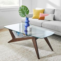 A new angle to displaying your favorite coffee table books, our Marcio Coffee Table's sculptural design echoes the dramatic shapes of Brazilian mid-century designs. Its dark walnut-finished base is crafted of wood certified to FSC® standar Walnut Veneer, Walnut Finish, Coffee Table Books, Modern Coffee Tables, Room Setup, Mid Century Design, Engineered Wood, Glass Table, West Elm