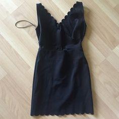 Black Top Shop Bodycon Dress Black Topshop Bodycon dress. crisscross detailing in the front. worn once. Topshop Dresses Mini