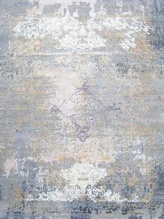 This beautiful dappled rug represents the scatter of leaves falling during autumn. Pale golds, blues and detailed handcarving signify unmistakeable quality.