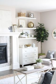 Modern-meets-traditional living room tour with lots of white and brass accents. Plus how to fake built-ins around your fireplace with these $15 floating shelves.