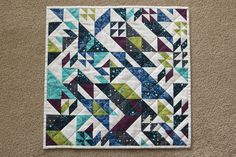 Mini quilt made by me for my partner in the Alison Glass IG swap. Pattern is the Mini Rebel by Libs Elliott.