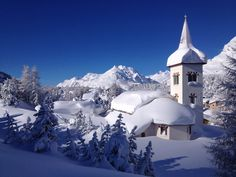 Snow World - San Gaudenzio church in Maloja. Switzerland