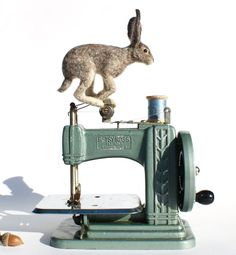 Antique Betsy Ross machine with needle-felted rabbit.