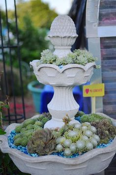 Old fountain/birdbath turned planter with succulents and colorful rocks!