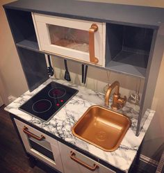 Do you own Ikea's Duktig — the kid's play kitchen? If so, check out these 16 insanely gorgeous DIYs to make the toy even cooler. Ikea Kids Kitchen, Diy Play Kitchen, Kitchen Benches, Toy Kitchen, Wooden Kitchen, Kitchen Sets, Kitchen Hacks, Toddler Kitchen, Types Of Kitchen Countertops