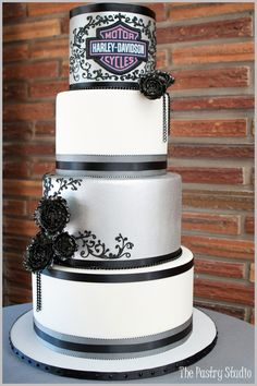 Harley Davidson wedding cake!  This would be perfect for my sister for even a birthday cake!!!!
