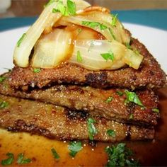 Irish Lassie's Liver and Onions Recipe Main Dishes with olive oil, garlic, sweet onion, chopped green bell pepper, red bell pepper, fresh mushrooms, salt, black pepper, butter, calf liver, all-purpose flour, cold water, beef bouillon granules, red wine