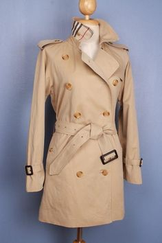 Stunning pre-owned Burberry trench coat, refurbished to a modern look, size S $349 This is a 100% genuine Burberry Trench Coat, customized by our master tailor to a Modern Short Trench Coat. Including the Burberry check to the back on the collar which looks fantastic when collar is turned up. More vintage Burberry coats in variable sizes and colors available in our shop. Use code Pinterest10 for a 10% discount on this coat at check out.