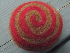 One multi-colored felted pin-cushion, Red and Brown by Dreamcrafter on Etsy