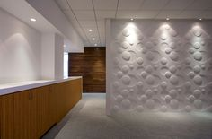 White on White on White | Green Building and Design, like the feature white circle wall.