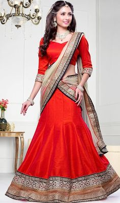 Look pretty beautiful dressed in this red dupioni raw silk lehenga choli. Beautified with lace and resham work. Upon request we can make round front/back neck and short 6 inches sleeves regular lehenga blouse also. # Roll over image to zoom We ship exact product shown in the picture however, color of the actual product may vary at times due to screen resolution, picture tube variance and operating system. #RedDupioniRawSilkLehengaCholi