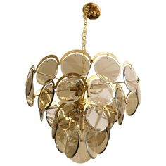 Italian Murano Vistosi Smoked Beveled Glass Disk and Brass Chandelier | From a unique collection of antique and modern chandeliers and pendants at https://www.1stdibs.com/furniture/lighting/chandeliers-pendant-lights/