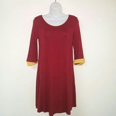 Mon Ami T shirt dress Maroon and Gold Size Small Mon Ami T shirt Dress, 96% Rayon, 4% Spandex. Maroon with gold cuff 3/4 sleeves.. Nice lightweight tshirt feel. Size Small. New without tags. Mon Ami Dresses Mini