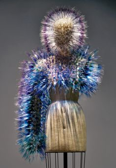 Spike Zone - While this headpiece and bolero set by Maiko Takeda (featured in the exhibition) may appear entirely machine-made, each piece of ombré acetate fringe was cut by hand—the ultimate manus x machina.