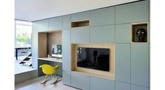 French studio Dank Architectes wanted to make this minimalist apartment they designed near Lyon look more alive in the photographs so they staged scenes depicting the day. Living Room Tv, Home And Living, Loft Conversion Types, Home Theaters, Minimalist Apartment, Minimalist Living, Cabinet Design, Built Ins, Home Interior Design
