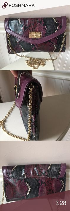 Aldo chain evening bag 💜 Beautiful color Aldo evening shoulder bag, chain strap, strap can be removed, small zipper pocket on inside, this bag is roomy, stylish and beautiful colors plum, black and some tan with gold chain and twist locket for closure, locket has a small tarnish sport on it nothing big or noticeable, picture included  Pet/smoke free home Aldo Bags Shoulder Bags
